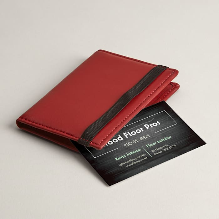 Folded red leather business card case