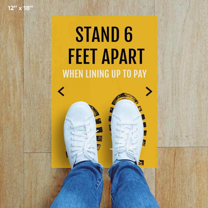 vertical floor decals stand 6 feet apart