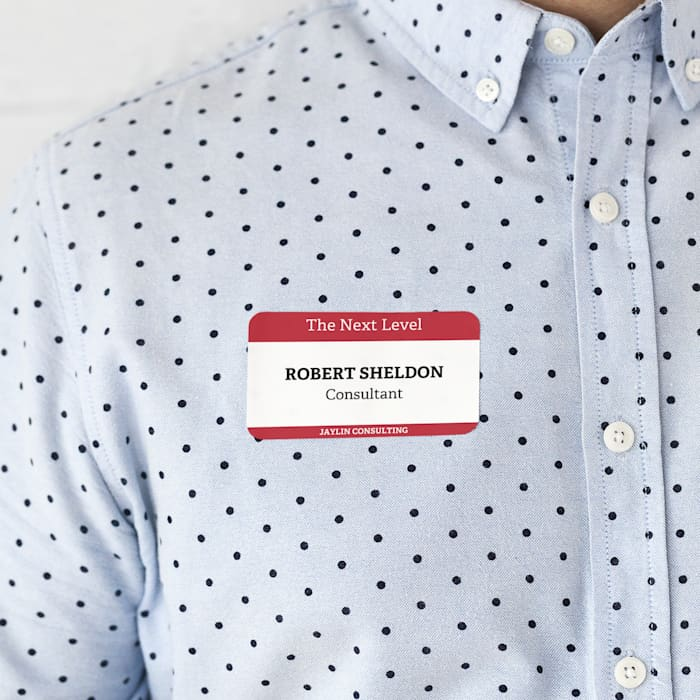 Branded name tag sticker on shirt