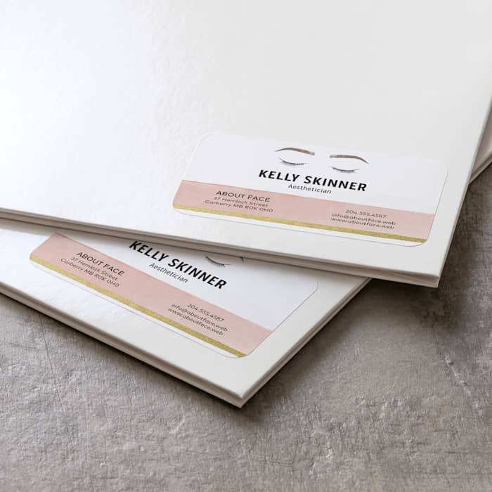 Business card stickers on folders