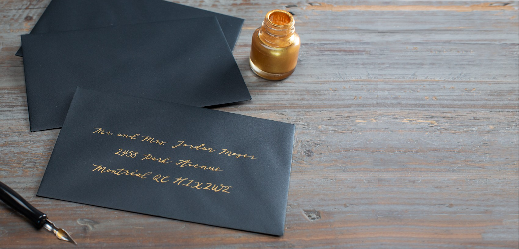 navy envelopes with gold writing