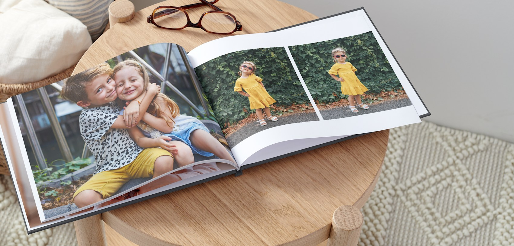 photo book with picture of two young children hugging